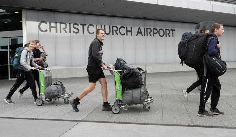 Tourists arrive at the Christchurch Airport terminal as they prepare to check in for a charter flight back to Germany via Vancouver from Christchurch, New Zealand.