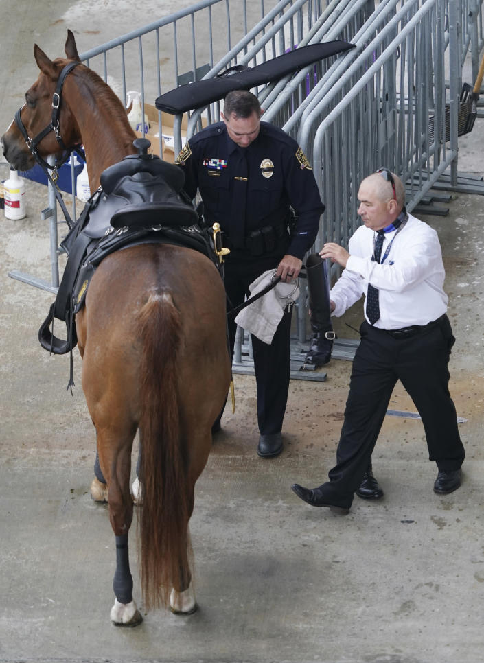 An honor guard horse is prepared to carry the symbolic empty boots prior to a memorial service for FBI Special Agent Laura Schwartzenberger, Saturday, Feb. 6, 2021, in Miami Gardens, Fla. Schwartzenberger and Special Agent Daniel Alfin were killed while serving a warrant this week in Sunrise, Fla. (AP Photo/Hans Deryk)