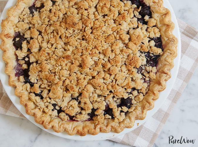 """<p>Two desserts coming together in streusel-topped harmony.</p> <p><a class=""""link rapid-noclick-resp"""" href=""""https://www.purewow.com/recipes/blueberry-crumble-pie"""" rel=""""nofollow noopener"""" target=""""_blank"""" data-ylk=""""slk:Get the recipe"""">Get the recipe</a></p>"""