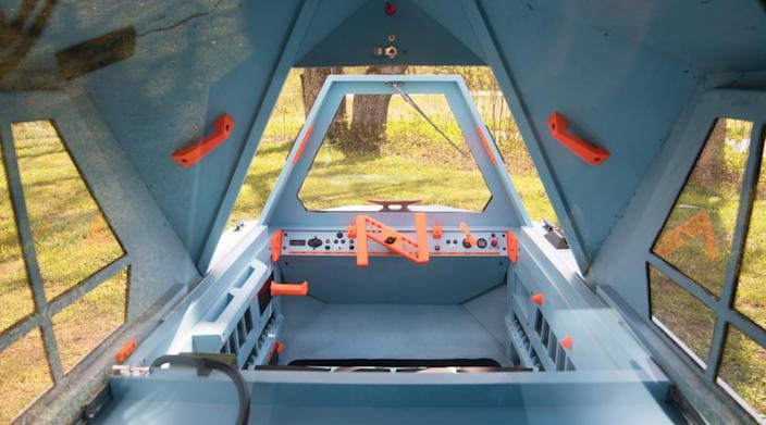 The interior of the Z-Triton camper boasts enough lounge/sleep space for two, as well as all the boat controls.