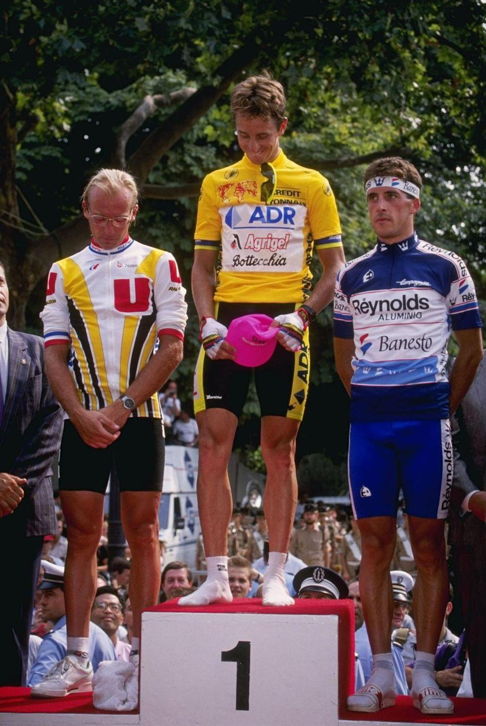 """<p>No final Tour stage has ever shocked the racing world like the 1989 Tour, when Greg LeMond clawed 58 seconds out of yellow jersey holder Laurent Fignon in just 24.5 kilometers with a stunning time trial ride. </p><p>But the final-day fireworks doesn't tell you that the '89 Tour was a see-saw battle for the entire race. Fignon won the Tour in 1983 and '84 but battled tendon issues in his knee and ankle in the following years. In 1989, he was finally back in top shape, having won May's Giro d'Italia (LeMond finished 39th). </p><p>The two traded yellow back and forth no fewer than five times during the Tour, separated by just a handful of seconds for much of the race. Riding for the underpowered ADR team, LeMond capitalized on time trials, where team strength and tactics aren't a factor, and seized yellow with a Stage 5 time trial win. He lost it shortly after to Fignon in the Pyrenees. Another strong time trial performance in Stage 15 reclaimed the lead for LeMond, but Fignon deployed his powerful Super-U team to take it back on Stage 17's Alpe d'Huez finish. He added 24 more seconds the next day, which many thought would be a comfortable enough margin to ensure the Frenchman's third Tour win ahead of the short, slightly downhill final stage.</p><p>LeMond had experimented with aero gear in the previous time trials, using a teardrop-shaped Giro helmet and the now-iconic clip-on handlebars in the 73-kilometer Stage 5 time trial. He donned that gear in the final stage, while Fignon opted to ride without either, choosing a conventional time trial bike with only cowhorn bars, and going bareheaded (<a href=""""https://www.bicycling.com/bikes-gear/a20012793/best-bike-helmets-reviews/"""" rel=""""nofollow noopener"""" target=""""_blank"""" data-ylk=""""slk:helmets"""" class=""""link rapid-noclick-resp"""">helmets</a> weren't mandatory in racing until 2003).</p><p>Much like Primož Roglič in the final TT of the 2020 Tour, Fignon was losing time to LeMond from the start. LeMond opted not to get time split"""