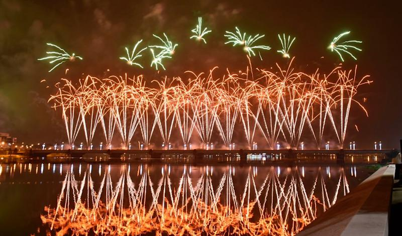 Fireworks light up the sky over the General de Gaulle bridge and the Ebrie lagoon during New Year's celebrations in Abidjan early on Jan. 1, 2020. | Sia Kambou—AFP/Getty Images