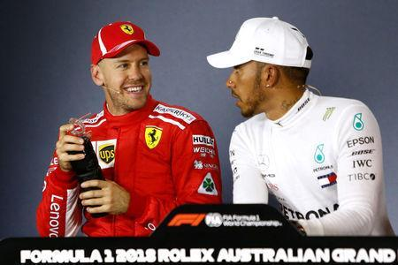 Formula One F1 - Australian Grand Prix - Melbourne Grand Prix Circuit, Melbourne, Australia - March 24, 2018 Ferrari's Sebastian Vettel and Mercedes' Lewis Hamilton during the press conference after qualifying REUTERS/Brandon Malone