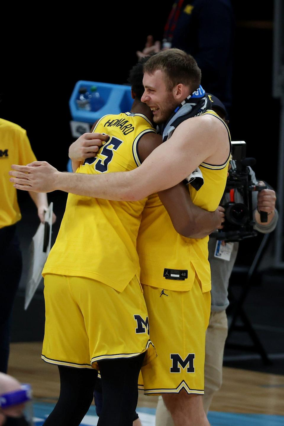 Michigan guard Jace Howard and forward Austin Davis celebrate after the 76-58 win over Florida State during the Sweet 16 game on Sunday, March 28, 2021, in Indianapolis.,