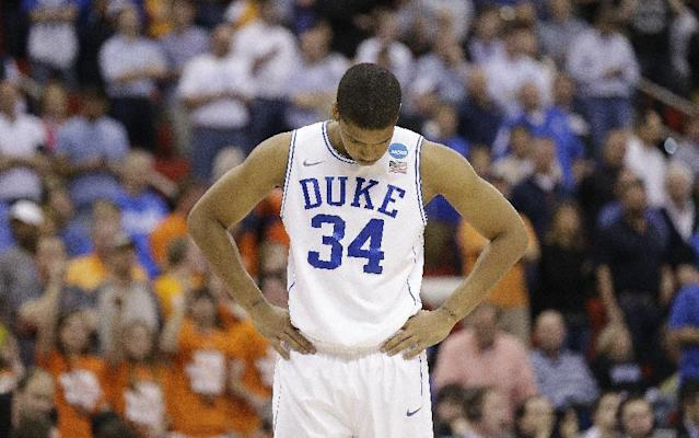Duke guard Andre Dawkins (34) walks off the court after the second half of an NCAA college basketball second-round game against Mercer, Friday, March 21, 2014, in Raleigh, N.C. Mercer won 78-71. (AP Photo/Gerry Broome)