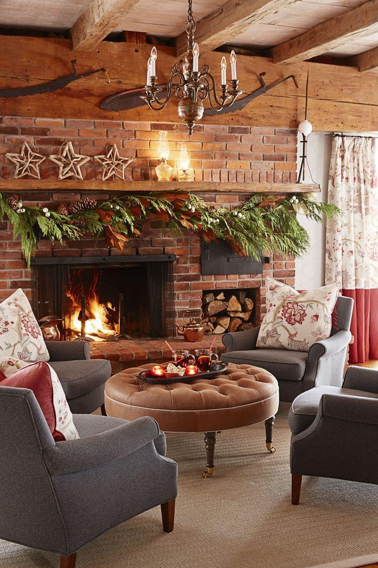<p>Lean on fresh greens to bring the drama to the hearth of your home: the fireplace. For a bolder statement, sprinkle in a mix of pinecones, ribbons, and berries. </p>