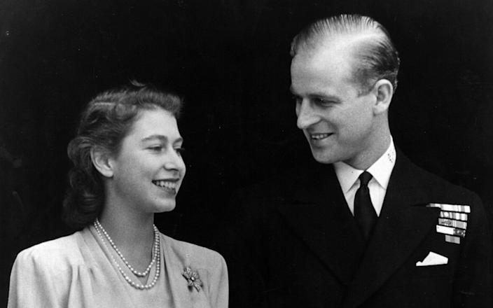 The Queen, then-HRH Princess Elizabeth and Philip Mountbatten, Duke of Edinburgh, on the occasion of their engagement at Buckingham Palace in London 1947 -  Fox Photos/Getty Images