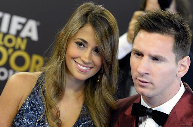 Soccer player Lionel Messi, right, of Argentina arrives with his wife Antonella, left, on the red carpet prior to the FIFA Ballon d'Or 2013 gala held at the Kongresshaus in Zurich, Switzerland, Monday, Jan. 13, 2014. (AP Photo/Keystone,Walter Bieri)