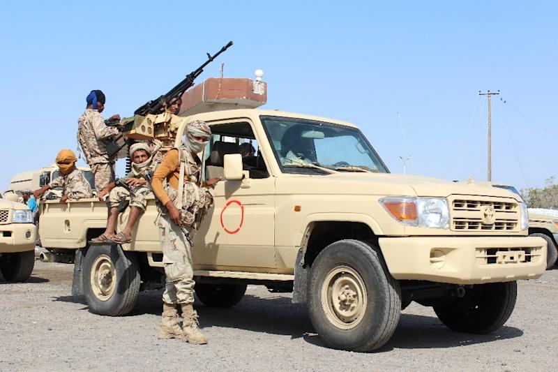 Yemeni pro-government forces stand guard at the entrance to Abyan province during an operation against Al-Qaeda fighters on April 23, 2016
