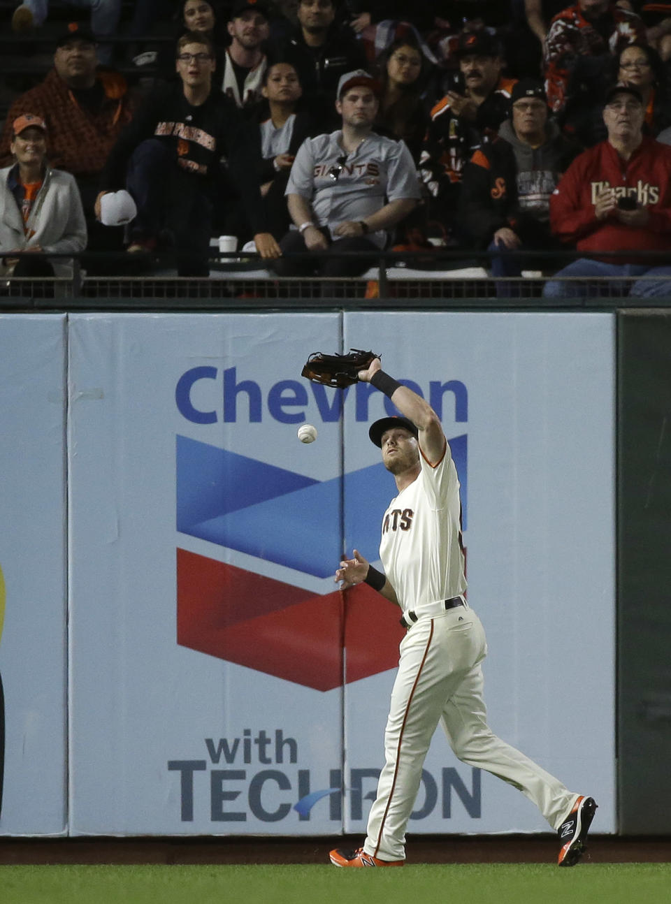 San Francisco Giants left fielder Austin Slater drops a fly ball hit by the Arizona Diamondbacks' Jon Jay in the seventh inning of a baseball game, Tuesday, Aug. 28, 2018, in San Francisco. Slater was given an error and Jay was safe at third base on the play. (AP Photo/Eric Risberg)