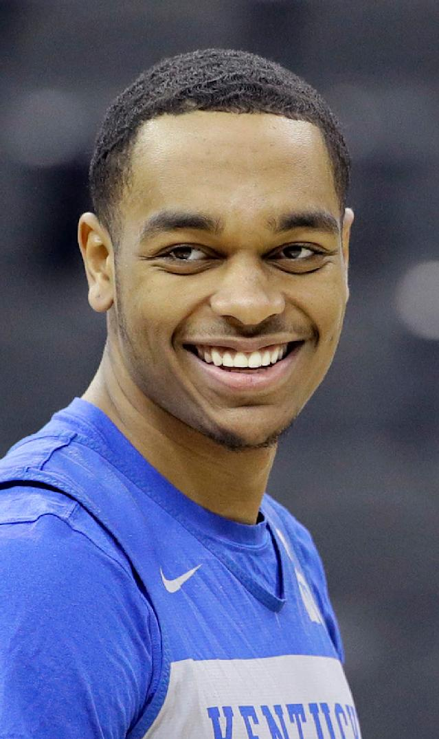 FILE - In this March 28, 2019, file photo, Kentucky's PJ Washington smiles during practice for the NCAA men's college basketball tournament, in Kansas City, Mo. The 6-8 sophomore brings length and athleticism inside along with the ability to step out of the paint, which could have him go late in the lottery at the NBA Draft. (AP Photo/Charlie Riedel, File)