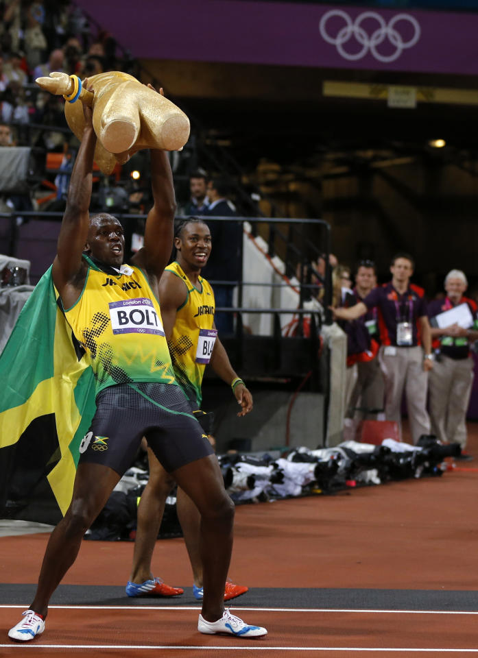 Jamaica's Usain Bolt holds a 'Wenlock' London 2012 Olympics mascot after he won the men's 100m final during the London 2012 Olympic Games at the Olympic Stadium August 5, 2012. Bolt set an Olympic record with a time of 9.63 seconds.   REUTERS/Phil Noble (BRITAIN  - Tags: OLYMPICS SPORT ATHLETICS)
