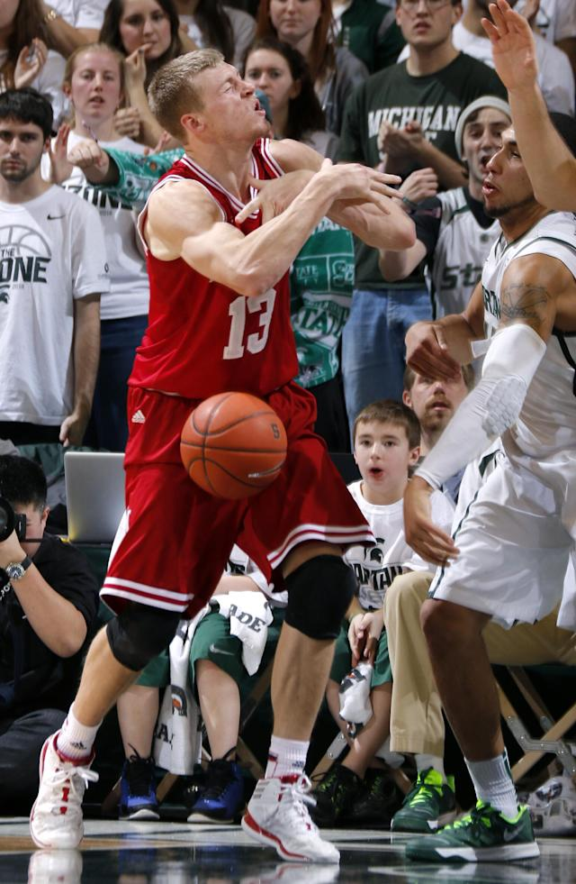 Michigan State's Denzel Valentine, right, strips the ball from Indiana's Austin Etherington (13) during the second half of an NCAA college basketball game, Tuesday, Jan. 21, 2014, in East Lansing, Mich. Michigan State won 71-66. (AP Photo/Al Goldis)