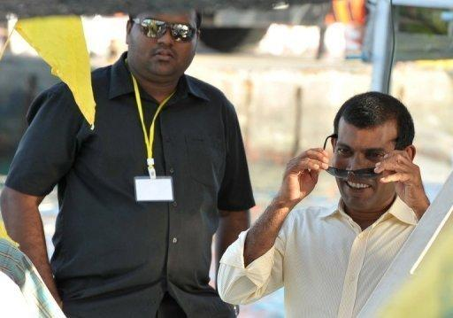 File photo shows former Maldives President Mohamed Nasheed (R), on a boat headed for the southern Maldives on October 1. Maldivian police arrested him on Monday, a week after he again failed to turn up for the start of a trial for abuse of power, his party said