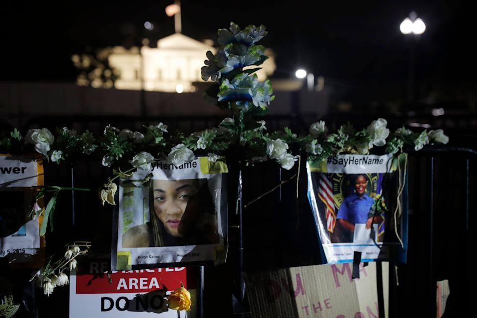 Photos of Korryn Gaines and Breonna Taylor, two Black women killed by police, are displayed in front of the White House in Washington, June 19, 2020, as people gathered here to mark Juneteenth, the holiday celebrating the day in 1865 that enslaved Black people in Galveston, Texas, learned they had been freed from bondage, more than two years after the Emancipation Proclamation.