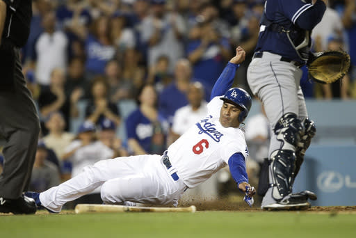 Los Angeles Dodgers' Jerry Hairston Jr. scores on a single hit by Adrian Gonzalez during the seventh inning of a baseball game against the San Diego Padres, Saturday, Aug. 31, 2013, in Los Angeles. (AP Photo/Jae C. Hong)