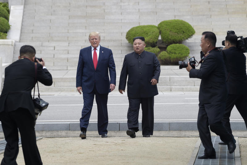 FILE - In this June 30, 2019, file photo, President Donald Trump, center left, and North Korean leader Kim Jong Un walk on the North Korean side at the border village of Panmunjom in the Demilitarized Zone. South Korea's President Moon Jae-in calls the recent U.S.-North Korean summit at the Korean border an end of mutual hostility between the countries. (AP Photo/Susan Walsh, File)