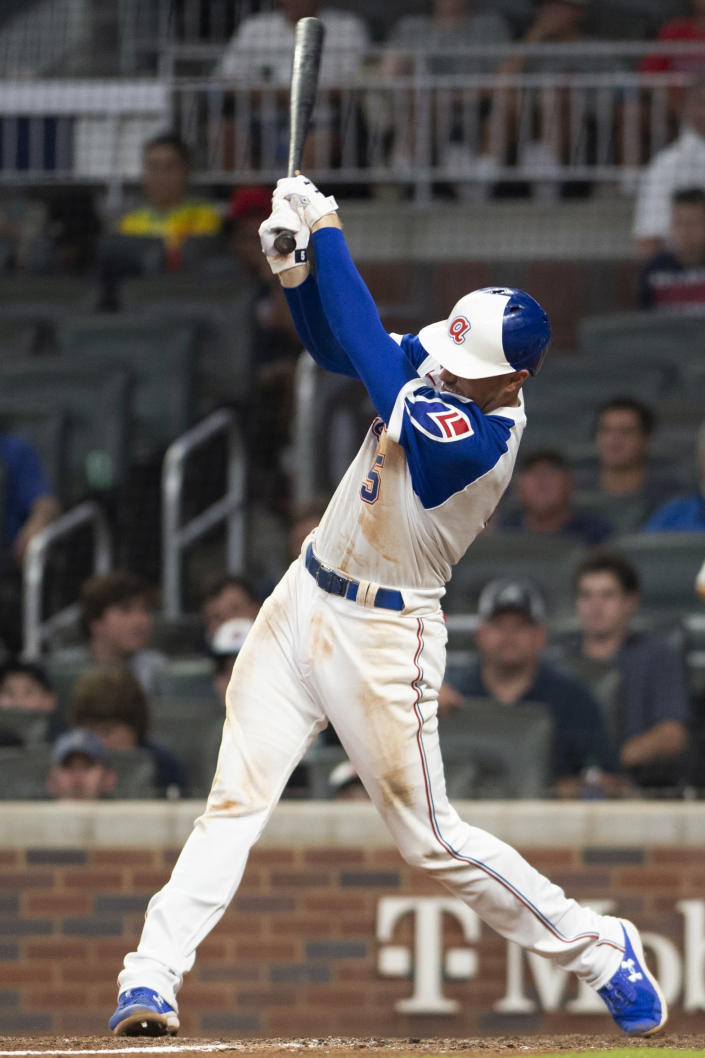 Freddie Freeman hits a single during the eighth inning of the team's baseball game against the Milwaukee Brewers, Saturday, July 31, 2021, in Atlanta. (AP Photo/Hakim Wright Sr.)