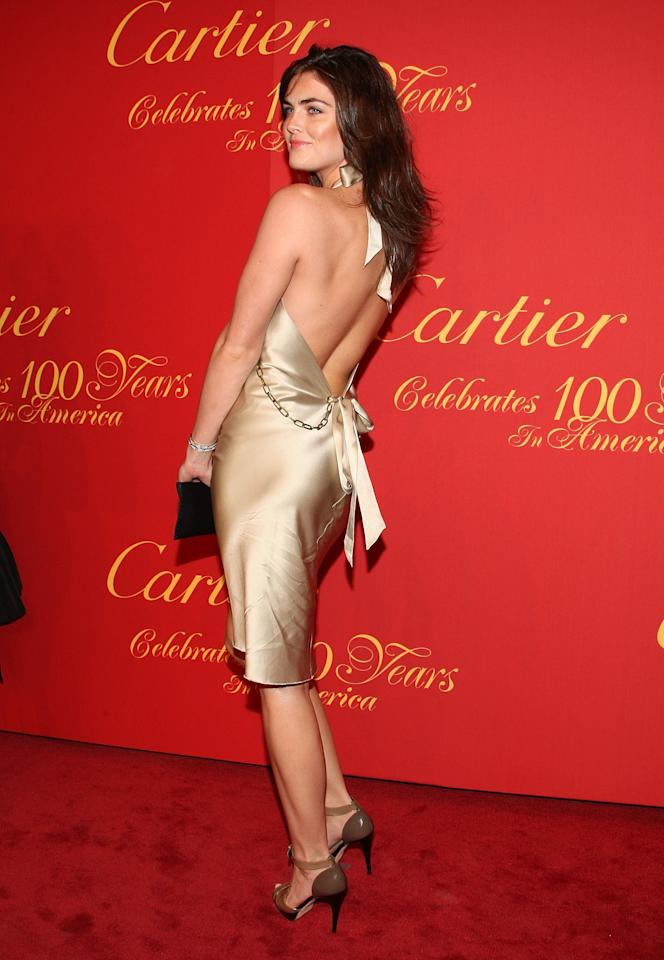 <p>Rhoda attends the Cartier 100th Anniversary in America Celebration at Cartier Fifth Avenue Mansion in a slinky gold dress. 2009.</p>