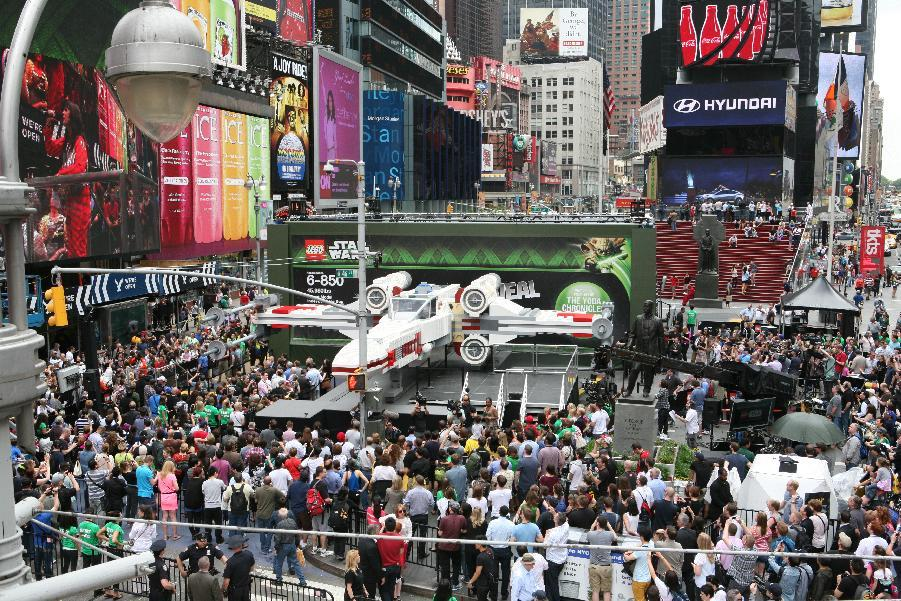 IMAGE DISTRIBUTED FOR LEGO SYSTEMS, INC. - Thousands gather in New York City's Times Square to watch the unveiling of the world's largest LEGO Model, a 1:1 replica of the LEGO Star Wars X-wing Starfighter that took 32 Model Builders, 5.3 million LEGO bricks and over 17,000 hours to complete, Thursday May 23, 2013. (Amy Sussman/AP Images for The LEGO Group)