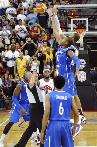 In this photo provided by the Las Vegas News Bureau, United States Olympic men's basketball team member Tyson Chandler, rear, tips off against Dominican Republic's Al Horford during an exhibition game, Thursday, July 12, 2012, in Las Vegas. The U.S. won 113-59. (AP Photo/Las Vegas News Bureau, Brian Jones)