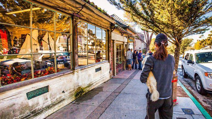 Carmel, United States - November 19 2011 : shopping on main street of carmel with luxurious expensive boutiques all around.