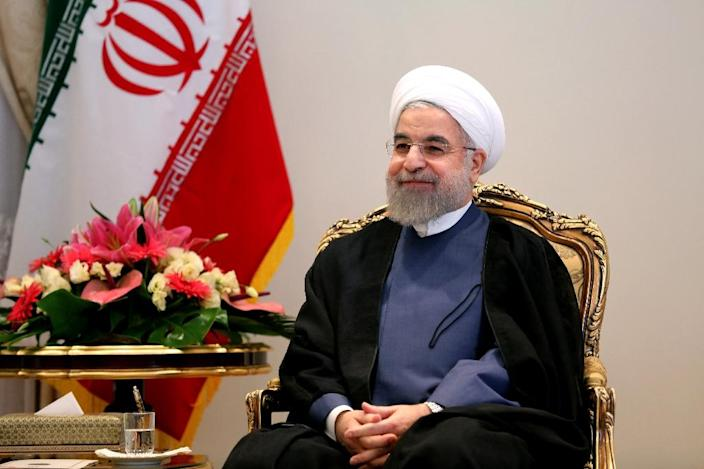 Iranian President Hassan Rouhani smiles during a meeting with German Economy and Energy Minister Sigmar Gabriel (unseen) in Tehran on July 20, 2015 (AFP Photo/Atta Kenare)