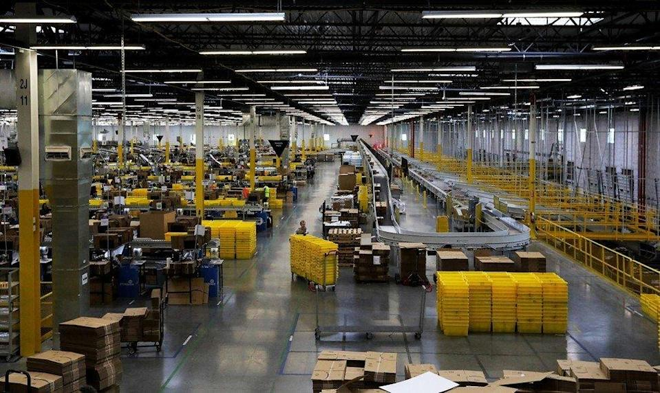 Workers are seen inside an Amazon.com fulfilment centre in Kent, a city in the greater Seattle area of Washington state. Photo: TNS