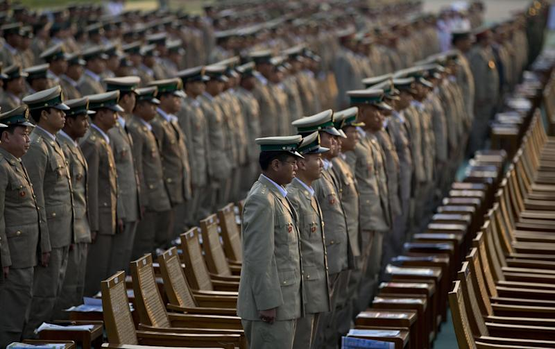 Myanmar's military officers stand during Myanmar's 68th anniversary celebrations of Armed Forces Day, in Naypyidaw, Myanmar, Wednesday, March 27, 2013. Myanmar's commander in chief said the military will continue to play a political role as it supports the country's transition to democracy. Speaking to thousands of troops at the annual Armed Forces Day celebration, Senior General Min Aung Hlaing said Wednesday that the military must strengthen its capabilities with modern weaponry and training. He also said the country would like to deepen military engagement with other countries, particularly within the Association of Southeast Asian Nations, and will abide by international human rights conventions. (AP Photo/Gemunu Amarasinghe)