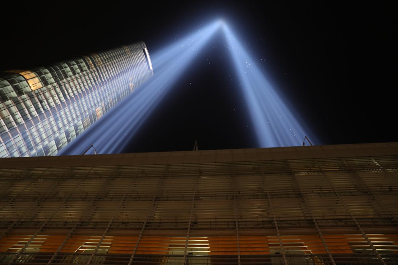 <p>The Tribute in Light rises above the skyline on the roof of the Battery Parking Garage on Sept. 11, 2017, the 16th anniversary of the 2001 terrorist attacks. (Gordon Donovan/Yahoo News) </p>