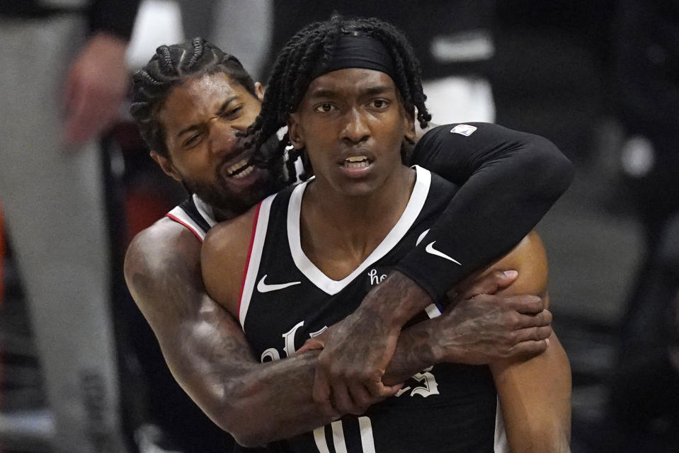 Los Angeles Clippers guard Terance Mann, right, celebrates with guard Paul George after scoring and drawing a foul during the first half in Game 6 of a second-round NBA basketball playoff series against the Utah Jazz Friday, June 18, 2021, in Los Angeles. (AP Photo/Mark J. Terrill)