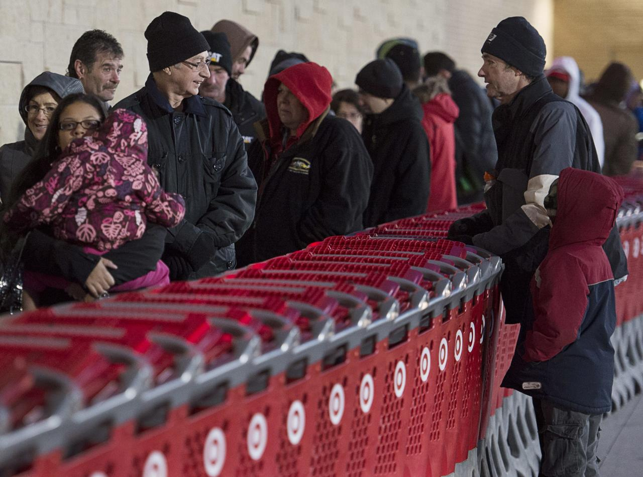 Shoppers wait in line at a Target store in Dartmouth, Nova Scotia, on Friday, Nov. 29, 2013. Black Friday, thought to be the most important shopping day of the year in the United States, is having an impact on Canadian sales as retailers work to keep consumers home, north of the border. (AP Photo/The Canadian Press, Andrew Vaughan)