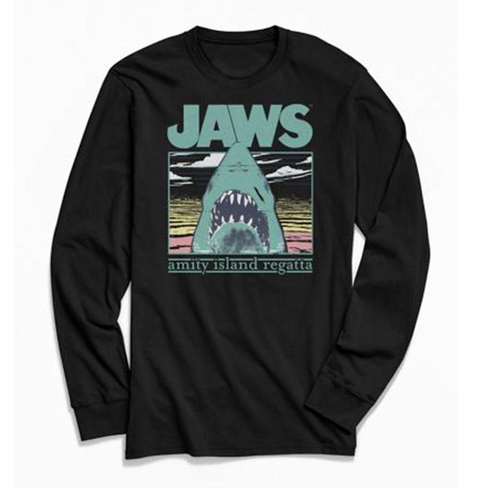 """<p><strong>Urban Outfitters</strong></p><p>urbanoutfitters.com</p><p><strong>$39.00</strong></p><p><a href=""""https://go.redirectingat.com?id=74968X1596630&url=https%3A%2F%2Fwww.urbanoutfitters.com%2Fshop%2Fjaws-amity-island-regatta-long-sleeve-tee&sref=https%3A%2F%2Fwww.menshealth.com%2Fstyle%2Fg35864339%2Fbest-graphic-t-shirts-men%2F"""" rel=""""nofollow noopener"""" target=""""_blank"""" data-ylk=""""slk:BUY IT HERE"""" class=""""link rapid-noclick-resp"""">BUY IT HERE</a></p><p>Graphic tees that are branded as funny are, if you can imagine, often not funny. Make it your kind of funny instead—like wearing a <em>Jaws </em>shirt near the beach. </p>"""