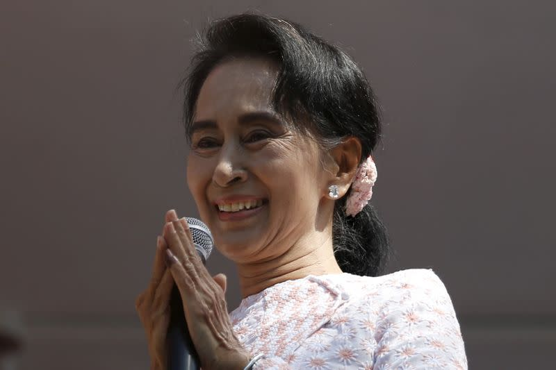 FILE PHOTO: Myanmar's National League for Democracy party leader Suu Kyi talks to supporters after general elections in Yangon