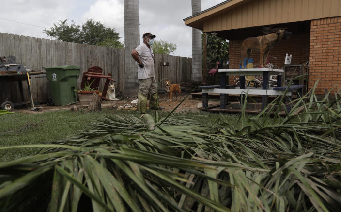 A man assesses damages as he returns to his home, Monday, July 27, 2020, in Weslaco,Texas. Ramos's was flooded by Hurricane Hanna as it passed through the area dropping heavy rains which caused flooding. (AP Photo/Eric Gay)