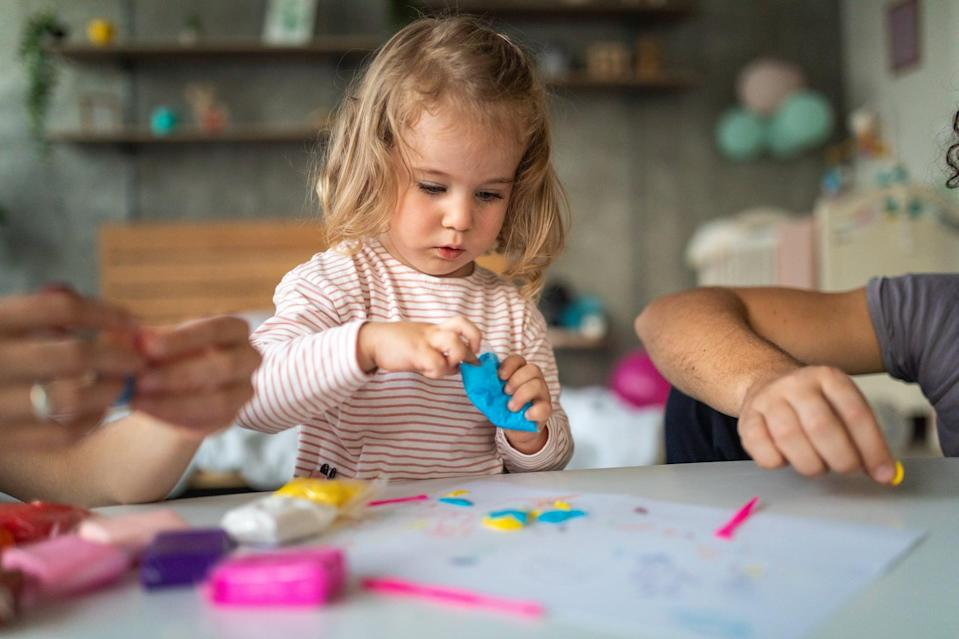 """<p>Child safe <a href=""""https://www.popsugar.com/family/Scented-Play-Dough-Recipe-24492319"""" class=""""link rapid-noclick-resp"""" rel=""""nofollow noopener"""" target=""""_blank"""" data-ylk=""""slk:do-it-yourself dough"""">do-it-yourself dough</a> or store-bought play dough can make for a seriously entertaining sensorial activity for your little one that engages their creativity, pretend play, fine motor skills, and potentially social skills. Set your child up in a safe space to play with their dough. This can be on a wipeable mat, outside, or on a small table. Offer them tools and objects that they can use to manipulate the dough. This can include Tupperware, child-safe utensils, child-safe cups, and any toys that are easily wiped down without any nooks such as small balls. Sit with your child and notice what they like to do with the dough, and build off of that. They may organize by color, make certain shapes, enjoy the squish between their fingers, or cover certain toys in it. They may also engage in pretend play and act as if it is food, try to feed you, or ask you to help them make a favorite animal or object.</p>"""
