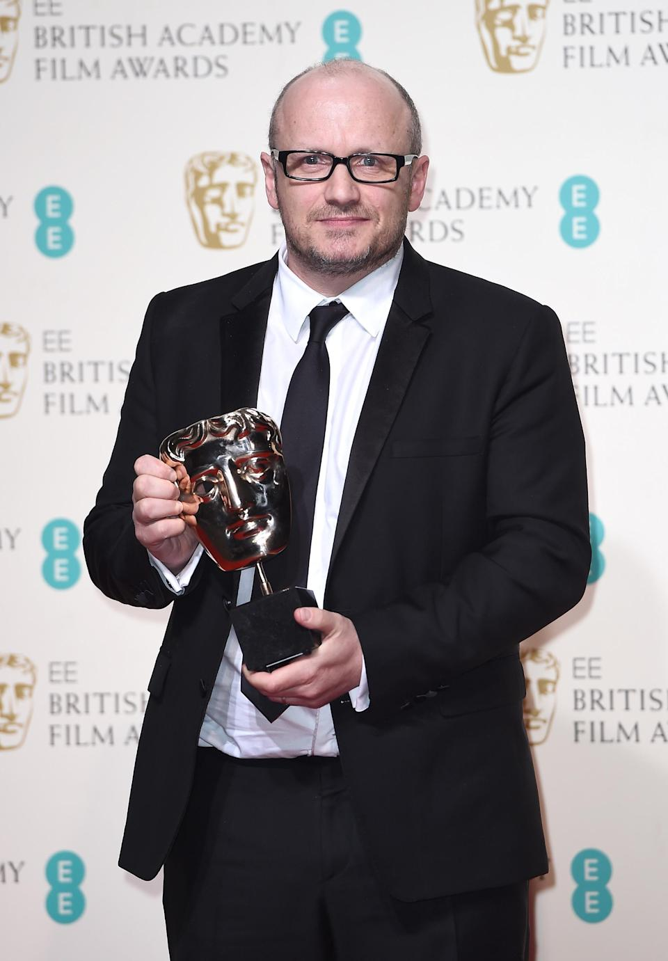 Lenny Abrahamson, accepting the Best Actress award on behalf of Brie Larson for 'Room' poses in the winners room at the EE British Academy Film Awards on February 14, 2016 in London, England. (Photo by Ian Gavan/Getty Images)