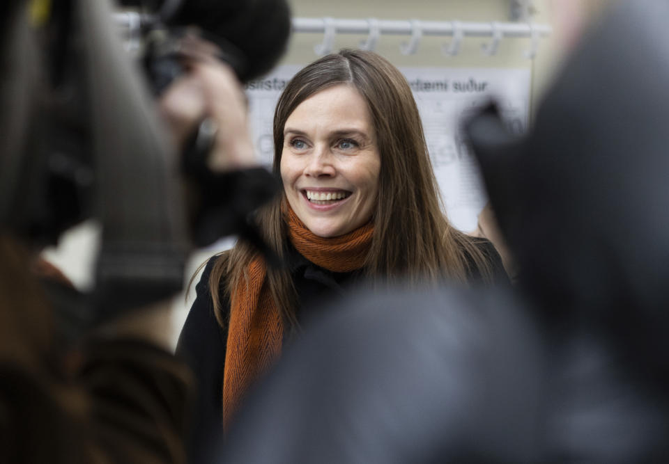 Iceland's Prime Minister Katrin Jakobsdottir speaks to the media after voting at a polling station in Reykjavik, Iceland, Saturday, Sept. 25, 2021. Icelanders are voting in a general election dominated by climate change, with an unprecedented number of political parties likely to win parliamentary seats. (AP Photo/Arni Torfason)