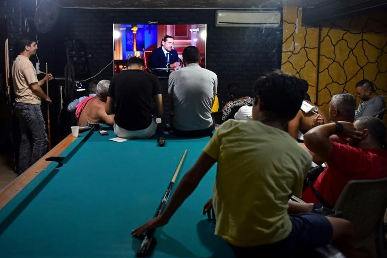 Lebanese watch a televised interview Thursday night of prime minister-designate Saad Hariri, who stepped down saying he was unable to form a government
