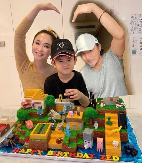 Christopher with his wife, Fann Wong, and their seven year-old son Zed