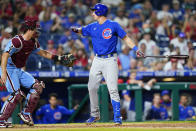 Chicago Cubs' Frank Schwindel, right, reacts after striking out against Philadelphia Phillies pitcher Hector Neris during the sixth inning of a baseball game, Thursday, Sept. 16, 2021, in Philadelphia. (AP Photo/Matt Slocum)