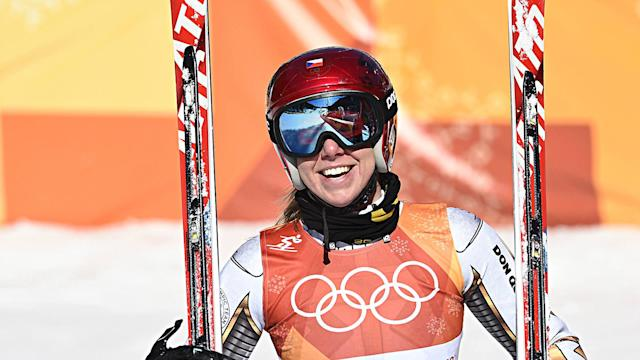 With borrowed skis on her feet, Ester Ledecka had the run of her life and earned a gold medal, beating Anna Veith by 0.01 seconds.