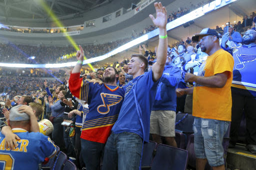 St. Louis Blues fans react during the final minutes of Game 7 of the team's NHL hockey Stanley Cup Final against the Boston Bruins, as they watch the broadcast of the game at Enterprise Center on Wednesday, June 12, 2019, in St. Louis. (AP Photo/Scott Kane)