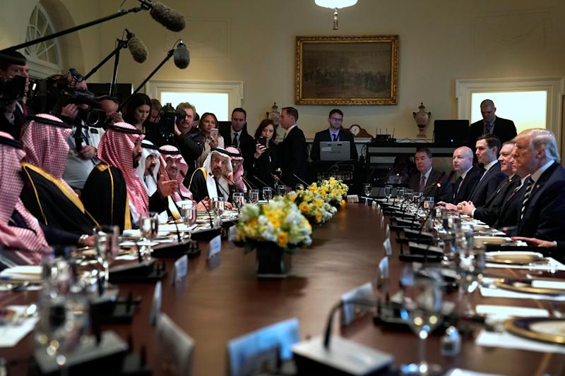 Donald Trump and Crown Prince Mohammed bin Salman sit down to a working lunch with their delegations at the White House on March 20, 2018. (Jonathan Ernst/Reuters)