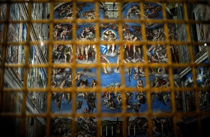 The Sistine Chapel with its new lighting is seen through a gate at the Vatican on October 29, 2014 (AFP Photo/Filippo Monteforte)