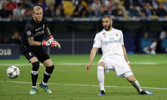 "Real Madrid's Karim Benzema, right, scores against <a class=""link rapid-noclick-resp"" href=""/soccer/teams/liverpool/"" data-ylk=""slk:Liverpool"">Liverpool</a> goalkeeper <a class=""link rapid-noclick-resp"" href=""/soccer/players/375090/"" data-ylk=""slk:Loris Karius"">Loris Karius</a> during the Champions League Final soccer match between Real Madrid and Liverpool at the Olimpiyskiy Stadium in Kiev, Ukraine, Saturday, May 26, 2018. (AP Photo/Sergei Grits)"