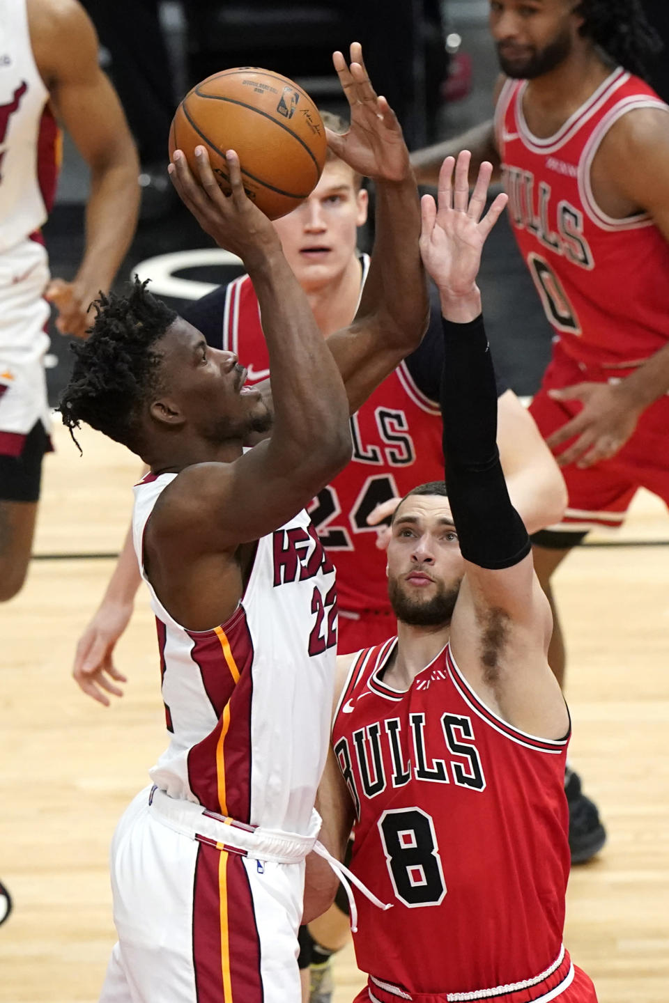 Miami Heat forward Jimmy Butler, left, shoots against Chicago Bulls guard Zach LaVine during the second half of an NBA basketball game in Chicago, Friday, March 12, 2021. (AP Photo/Nam Y. Huh)