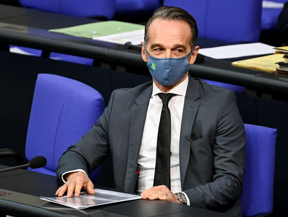 09 October 2020, Berlin: Heiko Maas (SPD), Foreign Minister, is sitting in his seat at the beginning of the Bundestag session with his mouth and nose protector. The debate will focus on the victims of the German wars of annihilation and the vote on the reform of family reunification in the EU. Photo: Britta Pedersen/dpa-Zentralbild/dpa (Photo by Britta Pedersen/picture alliance via Getty Images)