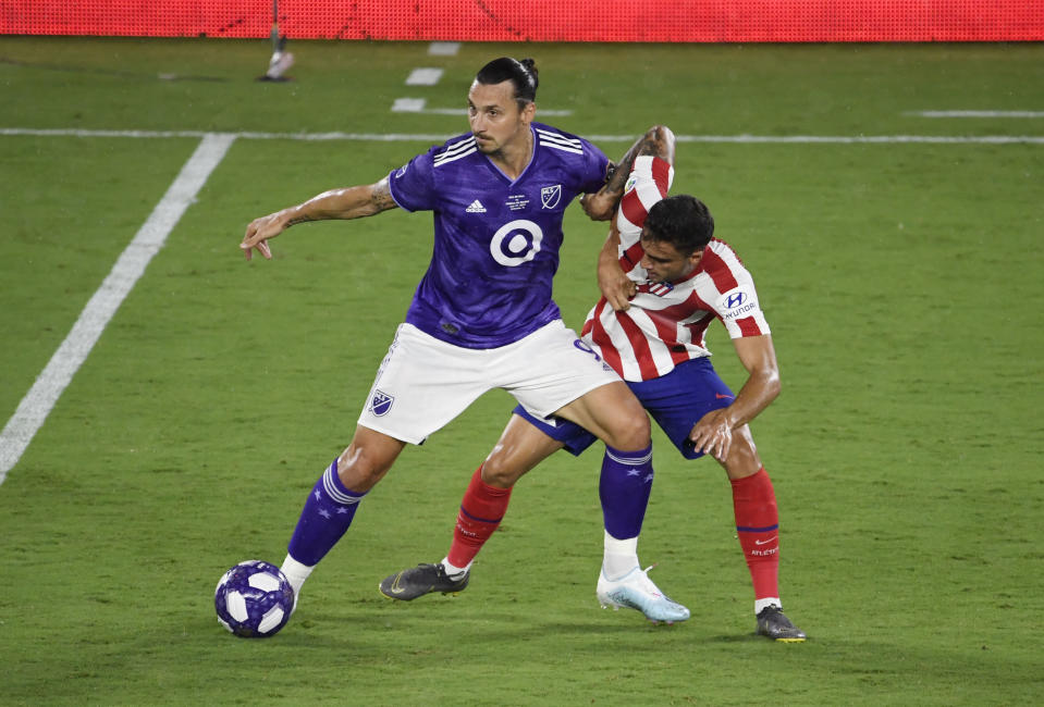 Jul 31, 2019; Orlando, FL, USA; MLS forward Zlatan Ibrahimovic (9) battles for the ball with Atletico Madrid defenseman Carlos Isaac (33) in the first half during the 2019 MLS All Star Game at Exploria Stadium. Mandatory Credit: Douglas DeFelice-USA TODAY Sports