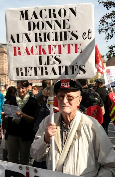 "The spark that lit the revolt was Macron's perceived bias towards the rich, notably by scrapping wealth taxes on investors at the same time as he raised taxes on pensioners. The banner reads ""Macron gives to the rich and cheats pensioners"""